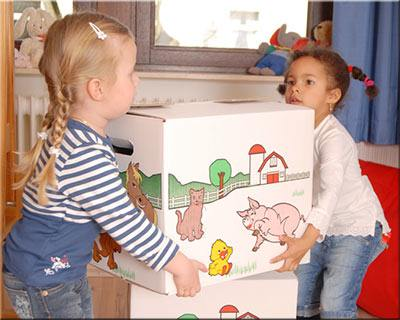 Children packing boxes